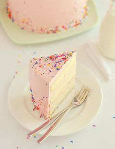 Confetti cake angel food cake, strawberry frosting, and colorful sprinkles