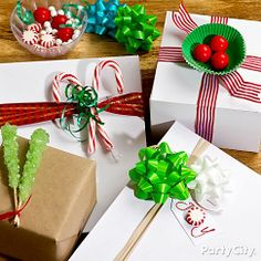 Candy is an easy and affordable way to add a special touch to plain packages! Click the pic to see how we made this eye-catching display and get more DIY Christmas gift wrap ideas.