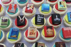 Tiny books made of icing sitting on cupcakes!