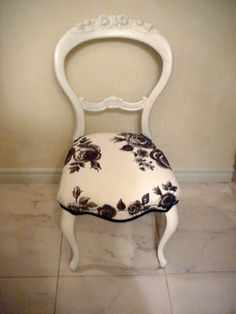 Lovely old balloon back chair painted a soft grey white, waxed and reupholstered in Ikea fabric and old French gimp trim.