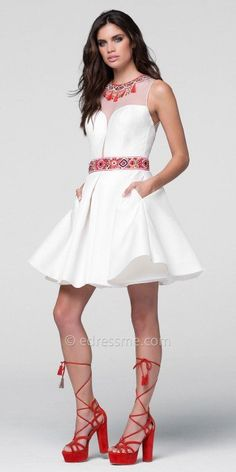 If your looking for a pretty little mini with a stylish and unique twist, the Box Pleated Tassel Illusion Cocktail Dress by Tarik Ediz Prom is an obvious choice. This charming number features a bead embellished illusion neckline, a sleeveless bodice and an illusion back with tassel embellishments. The fit and flare silhouette also includes taffeta fabric, a box pleated circle skirt, a beaded waistline and a zipper down the center back. #edressme