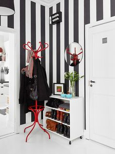 I just love the black and white stripe walls, the shoe storage unit as soon as you walk in the door, cus I sure know as soon as I walk in the door the first thing that comes off is my shoes! LOL. The pop of red in the coat rack is a nice touch too!