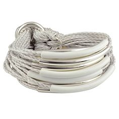 Gillian Julius Multi Tube Bracelet, Silver & White | White Cord. This bracelet is made up of 20 cords that each features a silver or white enamel tube.  Sterling silver plating and waxed cotton cord. $319