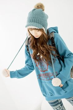 Cute, casual gyaru: Blue, knitted beanie with cap and faux fur details. Blue hoodie dress with red print. Nordic patterned withe and blue tights. Gray backpack.