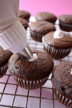 Cream filled chocolate cupcakes with chocolate ganache frosting. These would be a sweet Valentine's Day dessert. #recipe #cupcake #dessert skiptomylou.org