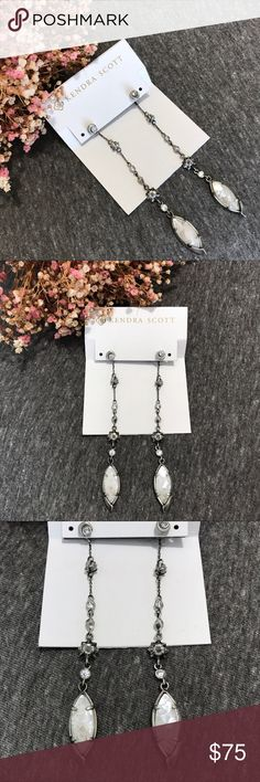 NWT Kendra Scott Lane Crackle Ivory Pearl Earrings A celestial blend of stars and moon these shoulder duster length antique silver chains are dotted with crystals and end with beautiful pieces of crackle ivory pearl! These ear jackets can be worn as studs or long earrings! Perfect condition, never worn! Kendra Scott Jewelry Earrings