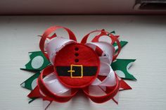 Christmas hair bow with santa feltie center,partially lined alligator clip on Etsy, $8.00