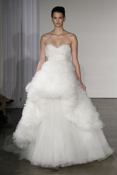 2. Marchesa Bridal F/W 2013. The front of this dress remind of bustle, but reversed to front instead of being at the back.