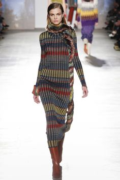 Missoni Fall 2017 Ready-to-Wear. Missoni can make knits so chic. I absolutely love and wish I could have this dress. It's amazingly sexy without showing any skin. The fit will show off your curves and aside from what I've always been told stripes can be sliming when the proportion is right. Head to toe will make ya long and lean!