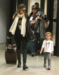 Alessandra Ambrosio was spotted arriving back in the states at Los Angeles International airport with her daughter this Wednesday, March 14 with daughter Anja.