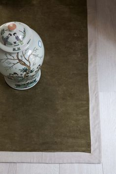 MarinaC - carpet in olive green linen velvet with natural linen border #marinacmilano www.marinac.it