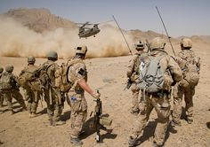 Afghan National Army commandos from the Special Operations Kandak and coalition forces (SEALs) during a village clearing operation in Shah Wali Kot district, Kandahar province, Afghanistan, Aug. Military Police, Military Weapons, Usmc, Marines, Military Personnel, Us Navy Seals, Special Ops, Special Forces, Military Photos
