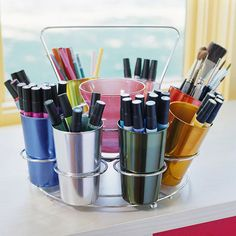Great idea for the craft room from BHG.Creative Container This aluminum tumbler set with a carrying caddy is a clever and colorful way to store art supplies. Look for inexpensive secondhand finds at thrift or antiques stores for fun storage solutions. Craft Room Storage, Craft Organization, Organizing Crafts, Pen Storage, Craft Rooms, Organisation Ideas, Table Storage, Office Storage, Hidden Storage