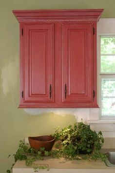 add molding to top and bottom of cupboards.....also really like the red!