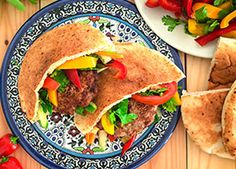 Sautéed pork is garnished with a refreshing cucumber sauce and stuffed in pita bread in this quick meal.