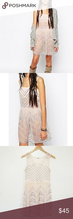 Free People Beaded Slip Dress Beautiful Free People Beaded Slip Dress. Size XS. 100% Nylon. Missing one bead, see sixth photo for details. Excellent Pre-Owned Condition! Free People Dresses
