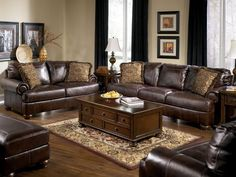 Brown leather sofa set for living room with dark hardwood floors ...