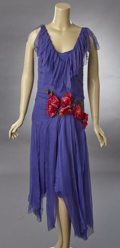 Late 20s to early 1930s perriwinkle blue silk chiffon dress with silk flower decoration. The dress has deep V neckline both front and back and still has its original slip. Surrounding the neckline is