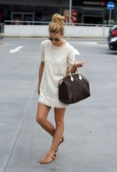 Make white lace fitted dress your outfit choice for a work-approved look. Brown leather gladiator sandals will add a new dimension to an otherwise classic look.   Shop this look on Lookastic: https://lookastic.com/women/looks/white-sheath-dress-brown-gladiator-sandals-dark-brown-duffle-bag-black-sunglasses/12548   — Black Sunglasses  — White Lace Sheath Dress  — Dark Brown Print Leather Duffle Bag  — Brown Leather Gladiator Sandals