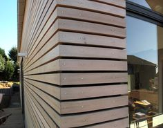 Horizontal slatted timber wall cladding with shadow line. Wooden Wall Cladding, Larch Cladding, House Cladding, Wood Facade, Exterior Cladding, Minimalist Architecture, Contemporary Architecture, Architecture Details, Decoration Facade