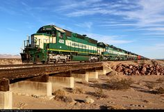 Not museum pieces yet! Having finished their work at Rice the Mojave Desert again echoes the chant of 6 second generation EMDs as they bring westbound tonnage on ARZC train 708 across the desert towards the BNSF at Cadiz, CA. Originally built in 1969 ARZC SD40M 4002 began life as Southern Pacific SD45 9005, later it was rebuilt as SD45R 7522. After its time with the SP was over it became a leaser and rebuilt as an SD40M, eventually finding its way to the ARZC.