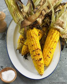 Grilled Corn on the Cob     Prep Time 15 minutes     Total Time 25 minutes     Yield Serves 4 Ingredients     4 ears of corn     Oil, for grates     1 tablespoon butter, cut into 4 pats     Coarse salt and ground pepper     Chili powder or paprika Directions     Peel back husks, leaving them attached at the base of the ear. Remove and discard silk; pull husks back over corn. Place ears in a large bowl or pot; cover with cold water. Let soak 10 minutes.     Preheat grill to high…
