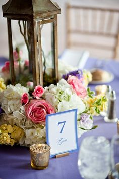 Lantern and flowers - rustic chic table number!