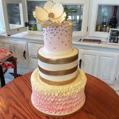 Pink and white ruffles. Gold and white stripes. Pink with gold pearls, topped by a handmade sugar flower. #peridotsweets
