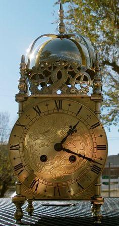 Clock Hourglass Time:  English lantern clock with bell striking.