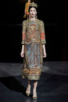 Italian designers Domenico Dolce and Stefano Gabbana took inspiration from golden Byzantine mosaics for their 2013-14 autumn-winter collection   (I like the silhouette, everything else is too literal. I like that they moved away from the sheer ornamentation of Lagerfeld's take and focused on the iconography, but its still not what i want to draw upon)
