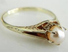 Hey, I found this really awesome Etsy listing at https://www.etsy.com/listing/204824740/vintage-14k-art-deco-pearl-ring