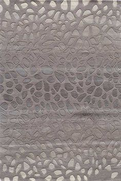 Delhi DL-33 Area Rug in Silver This 100% wool area rug has a beautiful subtle animal print.  #arearugs  #homedecor Available at SpacesHomeDecor.com