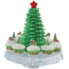 King of the Forest Cupcake and Cookies - There's nothing merrier for your Christmas table than a towering cookie tree, especially when it's surrounded by cupcakes accented with the Woodland Friends Cupcake Combo Pack. Our Christmas Cookie Tree Cutter Kit makes cutting and stacking the star-shaped cookies easy.