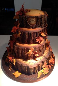 This fall wedding cake with the couple's initials carved into it is so romantic!