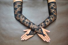 Lovely GOTHIC ELEGANT extra long gloves made of black high quality elastic lace, finished with rubber-lace.  Gloves are made in one size and match best size medium. If You need another size, contact me and I will do special order for You,  Find me on Facebook :)  https://www.facebook.com/sophieandherstore