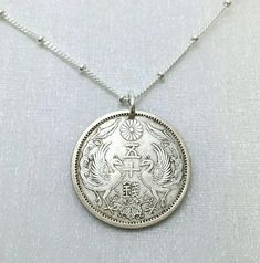 Hey, I found this really awesome Etsy listing at https://www.etsy.com/listing/157345927/silver-coin-necklace-antique-japanese