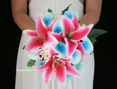 Turquoise beach theme and destination wedding bouquet with stargazer lilies and turquoise calla lilies