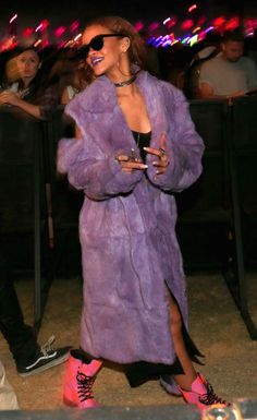 Even in the dessert, she arrives at Coachella wearing a floor-length purple fur coat with hot pink combat boots.