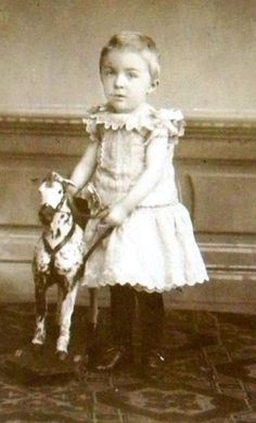 Boy with his rocking horse