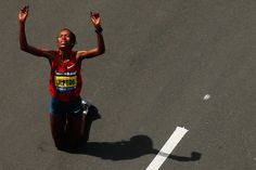Rita Jeptoo of Kenya reacts after finishing in first place in the women's division with an official time of 2:28:57 during the 2014 B.A.A. Boston Marathon in Boston, Massachusetts. (Jared Wickerham—Getty Images)