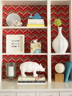 A patterned backdrop is gorgeous--and so easy. Just measure the space of each cubby and cut a piece of cardboard to those dimensions. (Check the fit before going further.) Using fabric, wallpaper, or even your favorite wrapping paper, tightly wrap the cardboard like a gift. Push it to the back of the shelf: done!