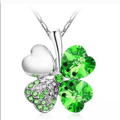 Green sparkly 4 leaf clover heart necklace Green sparkly 4 leaf clover heart necklace.   Actual color of item may be a little different than it looks in the photo Jewelry Necklaces