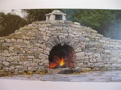 Incorporate a fireplace into your stone wall. Canadian waller Stephen Niven won a prize in 2009 with this dry stone fireplace. Dry Stack Stone, Stacked Stone Walls, Stacked Stone Fireplaces, Rock Fireplaces, Dry Stone, Outdoor Stone, Outdoor Fire, Outdoor Living, Stone Fireplace Wall