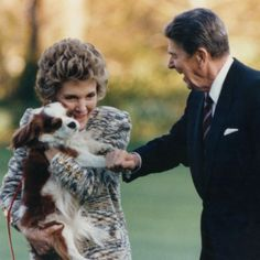 First Dog Rex gets a hug from the First Lady Nancy Reagan and a pawshake from President Ronald Reagan. - UPI.com