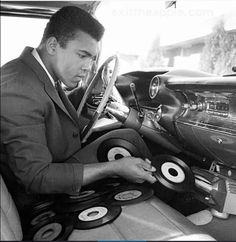 """vinylespassion: """"Cassius Clay (Muhammad Ali) and the custom made record player of his 1960 Cadillac. """" vinylespassion: """"Cassius Clay (Muhammad Ali) and the custom made record player of his 1960 Cadillac. Vinyl Record Player, Record Players, Vinyl Records, 45 Records, Vinyl Music, Vinyl Art, The Addams Family, Lps, Fred Flintstone"""
