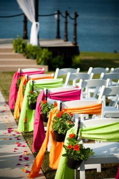Kinda like this idea- very eye-catching and simple =P   Your Event Solution  www.4yes.com  Weddings  Pink Green Orange  Ceremony  Pine Isle Point  Lake Lanier Islands