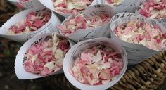 By providing confetti cones, each guest has a small amount of confetti petals to throw.