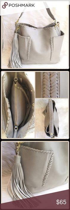 """JUST INWHIP STITCHED BUCKET BAG Headed out for a day grab this chic bag and have fun! ▪️PVC  ▪️Magnetic snap closure ▪️Top handle whip stitch detail  ▪️Detachable adjustable crossbody strap-46"""" Drop 23"""" ▪️2 exterior side slip pockets ▪️Flat base ▪️Detachable tassel ▪️Interior center zip bag ▪️W 11.5"""" x D 6.5"""" x H 10"""" ▪️Handle L 14"""" Drop 8.5""""   2+ BUNDLE=SAVE  ‼️NO TRADES   Brand Authentic   ✈️ Ship Same Day--Purchase By 2PM PST   USE BLUE OFFER BUTTON TO NEGOTIATE   ✔️ Ask Questions Not…"""