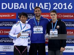 Silver medal winner Takeshi Kawamoto of Japan, Gold medal winner Chad Le Clos of South Africa and Bronze medal winner Pavel Sankovich of Bulgaria celebrate on the podium after the Men's 100m Butterfly finals during day two of the FINA Swimming World Cup Dubai 2016 at Hamdan Sports Complex on October 5, 2016 in Dubai, United Arab Emirates.