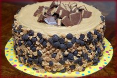 REESES OVERLOAD CAKE-2 PEANUT BUTTER BLONDIE LAYERS, 1 CHOCOLATE CHEESECAKE LAYER FILLED WITH AN INTENSE CHOCOLATE FROSTING, TOPPED WITH PB FROSTING
